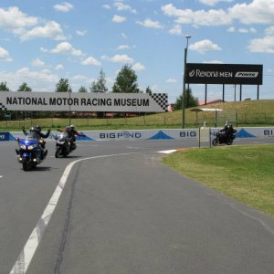 Friends entering the start straight at Mount Panorama circuit.